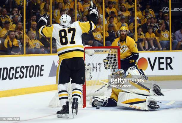 Sidney Crosby of the Pittsburgh Penguins celebrates after Jake Guentzel scored a first period goal against Pekka Rinne of the Nashville Predators in...