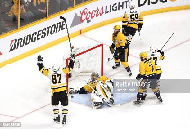Sidney Crosby of the Pittsburgh Penguins celebrates after Jake Guentzel of the Pittsburgh Penguins scored a first period goal against Pekka Rinne of...