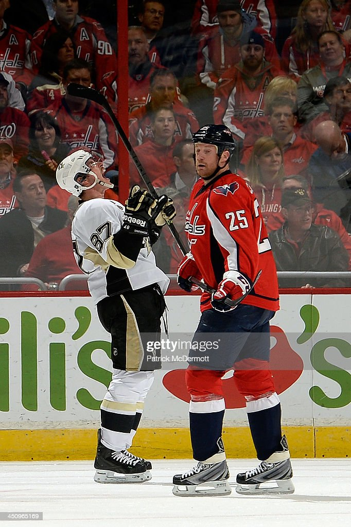 <a gi-track='captionPersonalityLinkClicked' href=/galleries/search?phrase=Sidney+Crosby&family=editorial&specificpeople=212781 ng-click='$event.stopPropagation()'>Sidney Crosby</a> #87 of the Pittsburgh Penguins celebrates after scoring a goal in the second period during an NHL game against the Washington Capitals at Verizon Center on November 20, 2013 in Washington, DC.