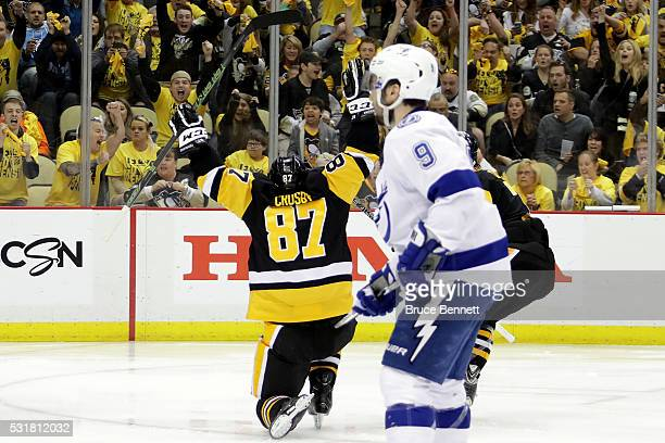 Sidney Crosby of the Pittsburgh Penguins celebrates after scoring a goal in overtime against Andrei Vasilevskiy of the Tampa Bay Lightning to win...