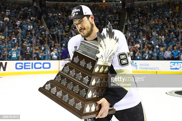 Sidney Crosby of the Pittsburgh Penguins celebrates being awarded the Conn Smythe after their 31 victory to win the Stanley Cup against the San Jose...