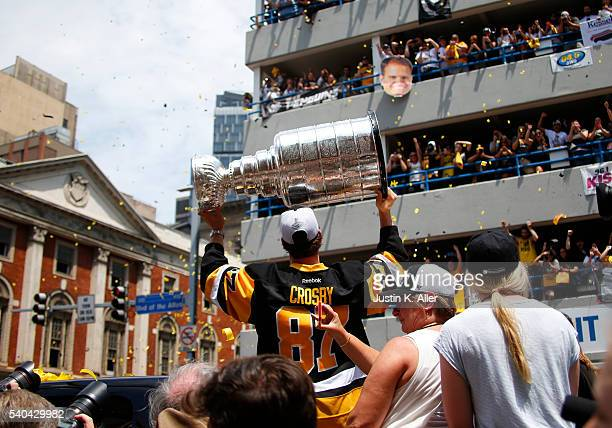 Sidney Crosby of the Pittsburgh Penguins celebrates during the Victory Parade and Rally on June 15 2016 in Pittsburgh Pennsylvania