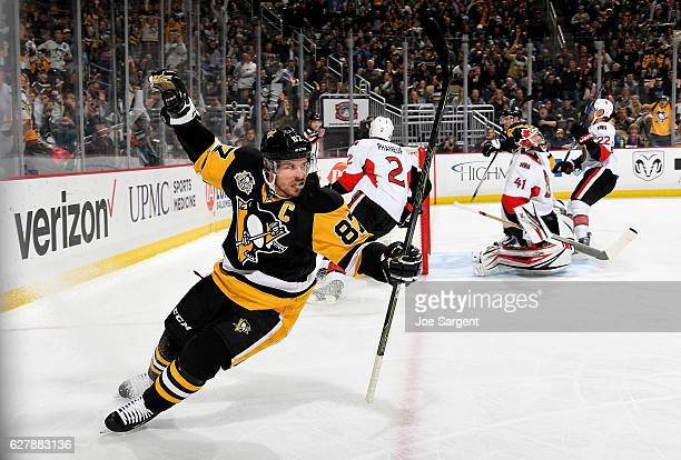 Sidney Crosby of the Pittsburgh Penguins celebrates his first period goal against Craig Anderson of the Ottawa Senators at PPG Paints Arena on...