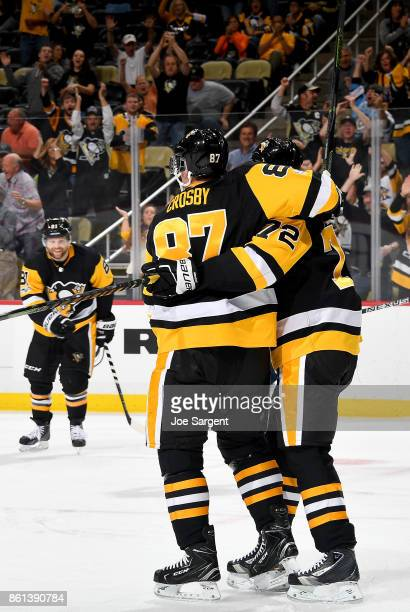 Sidney Crosby of the Pittsburgh Penguins celebrates his first period goal with Patric Hornqvist and Phil Kessel of the Pittsburgh Penguins against...