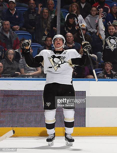 Sidney Crosby of the Pittsburgh Penguins celebrates his game tying goal at 800 of the third period against the New York Islanders at the Nassau...