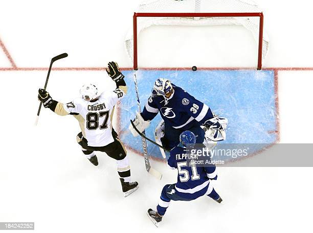 Sidney Crosby of the Pittsburgh Penguins celebrates his goal against goalie Anders Lindback and Valtteri Filppula the Tampa Bay Lightning during the...