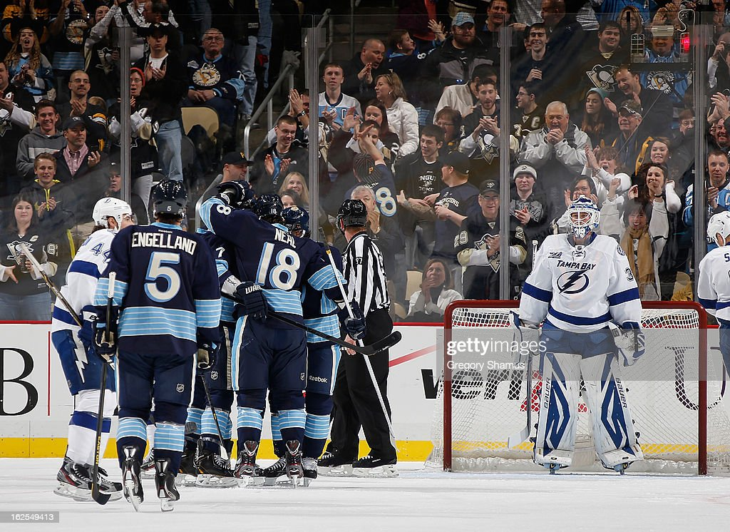Sidney Crosby #87 of the Pittsburgh Penguins celebrates his goal with teammates in front of Anders Lindback #39 of the Tampa Bay Lightning on February 24, 2013 at Consol Energy Center in Pittsburgh, Pennsylvania.