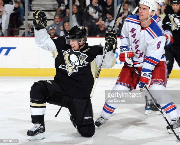 Sidney Crosby of the Pittsburgh Penguins celebrates his second goal of the game in front of Wade Redden of the New York Rangers on February 12 2010...