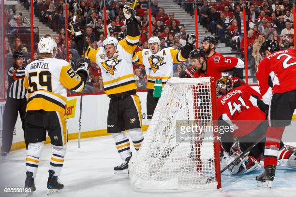 Sidney Crosby of the Pittsburgh Penguins celebrates his second period goal along with Jake Guentzel and Evgeni Malkin against Craig Anderson Cody...