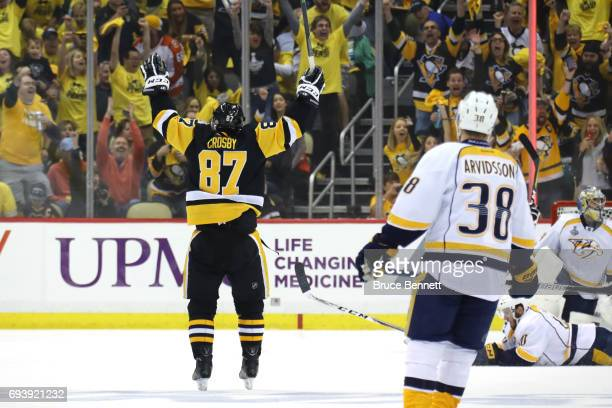Sidney Crosby of the Pittsburgh Penguins celebrates his team's fifth goal by Phil Kessel against the Nashville Predators in Game Five of the 2017 NHL...