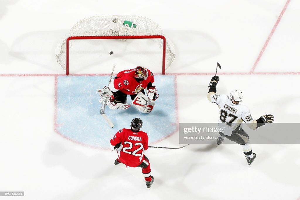 Sidney Crosby of the Pittsburgh Penguins celebrates his third period goal against Craig Anderson and Erik Condra of the Ottawa Senators in Game Four...