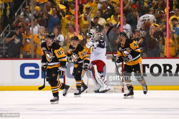 Sidney Crosby of the Pittsburgh Penguins celebrates his third period goal in front Sergei Bobrovsky of the Columbus Blue Jackets in Game Five of the...