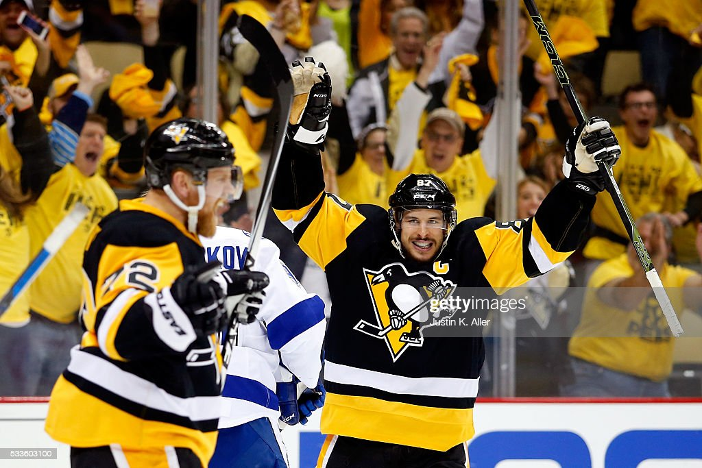 Sidney Crosby #87 of the Pittsburgh Penguins celebrates teammate Patric Hornqvist #72 of the Pittsburgh Penguins second period goal against Andrei Vasilevskiy #88 of the Tampa Bay Lightning in Game Five of the Eastern Conference Final during the 2016 NHL Stanley Cup Playoffs at Consol Energy Center on May 22, 2016 in Pittsburgh, Pennsylvania.