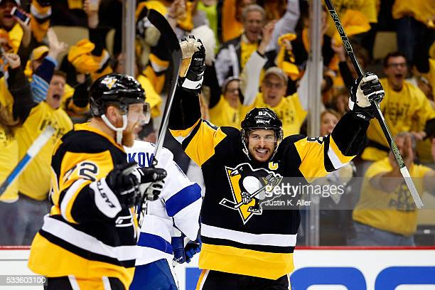 Sidney Crosby of the Pittsburgh Penguins celebrates teammate Patric Hornqvist of the Pittsburgh Penguins second period goal against Andrei...