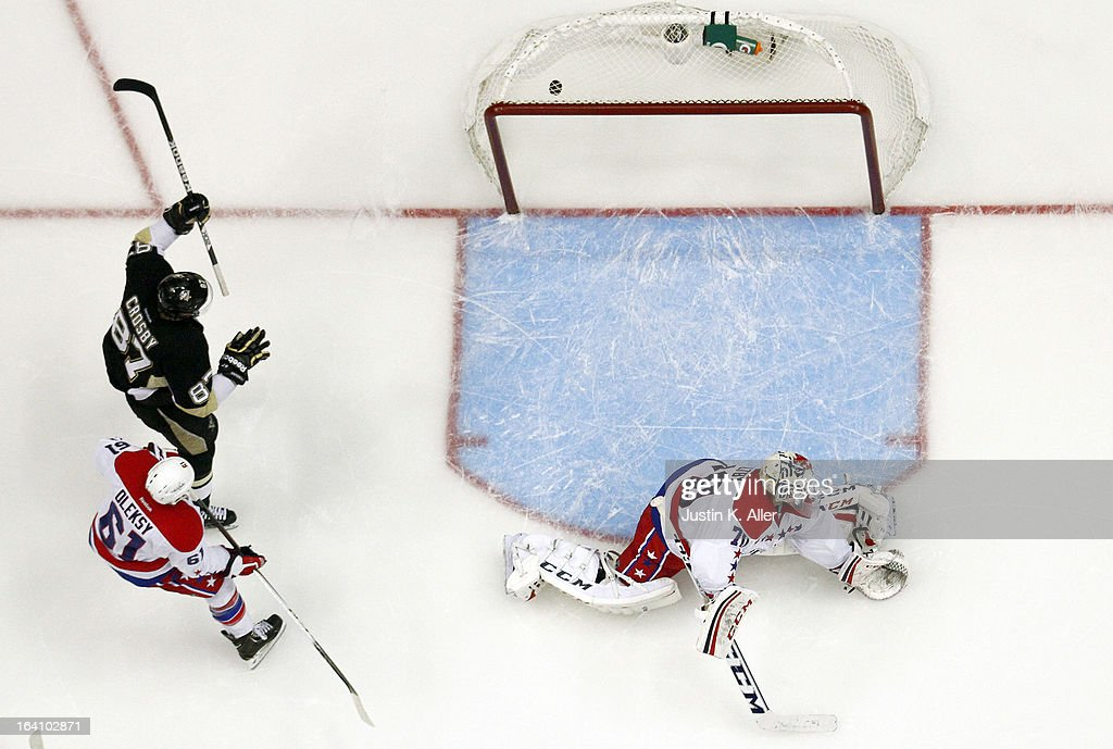 <a gi-track='captionPersonalityLinkClicked' href=/galleries/search?phrase=Sidney+Crosby&family=editorial&specificpeople=212781 ng-click='$event.stopPropagation()'>Sidney Crosby</a> #87 of the Pittsburgh Penguins celebrates the game winning goal by Matt Niskanen #2 (not pictured) in the third period against <a gi-track='captionPersonalityLinkClicked' href=/galleries/search?phrase=Braden+Holtby&family=editorial&specificpeople=5370964 ng-click='$event.stopPropagation()'>Braden Holtby</a> #70 of the Washington Capitals during the game at Consol Energy Center on March 19, 2013 in Pittsburgh, Pennsylvania. The Penguins defeated the Capitals 2-1.