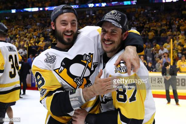 Sidney Crosby of the Pittsburgh Penguins celebrates with Brian Dumoulin after they defeated the Nashville Predators 20 in Game Six of the 2017 NHL...