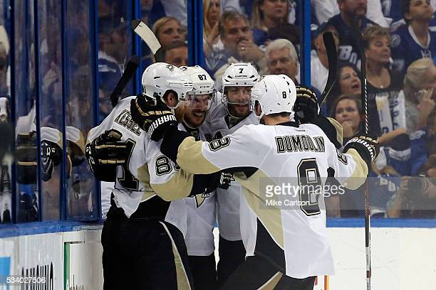 Sidney Crosby of the Pittsburgh Penguins celebrates with his teammates after scoring a goal against Andrei Vasilevskiy of the Tampa Bay Lightning...