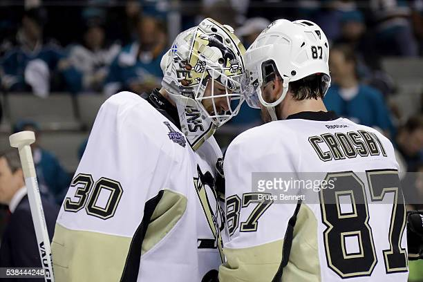 Sidney Crosby of the Pittsburgh Penguins celebrates with Matt Murray after defeating the San Jose Sharks 31 in Game Four of the 2016 NHL Stanley Cup...