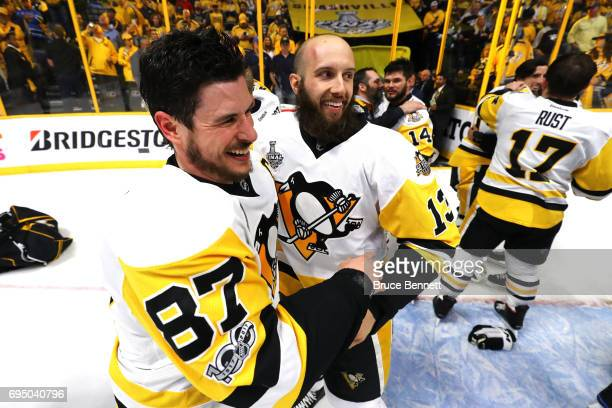 Sidney Crosby of the Pittsburgh Penguins celebrates with Nick Bonino after defeating the Nashville Predators 20 in Game Six of the 2017 NHL Stanley...