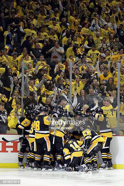 Sidney Crosby of the Pittsburgh Penguins celebrates with teammates after scoring a goal in overtime against Andrei Vasilevskiy of the Tampa Bay...