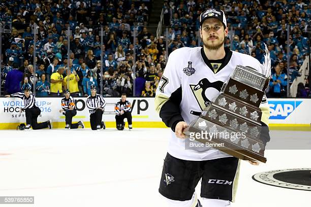 Sidney Crosby of the Pittsburgh Penguins celebrates with the Conn Smythe Trophy after their 31 victory to win the Stanley Cup against the San Jose...