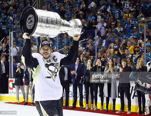 Sidney Crosby of the Pittsburgh Penguins celebrates with the Stanley Cup after their 31 victory to win the Stanley Cup against the San Jose Sharks in...