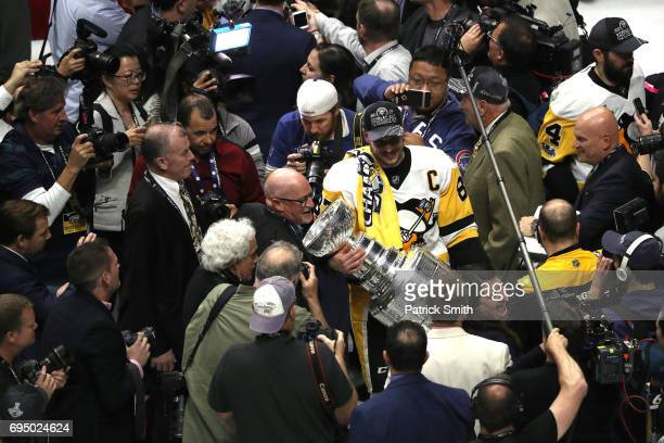 Sidney Crosby of the Pittsburgh Penguins celebrates with the Stanley Cup trophy after they defeated the Nashville Predators 20 to win the 2017 NHL...