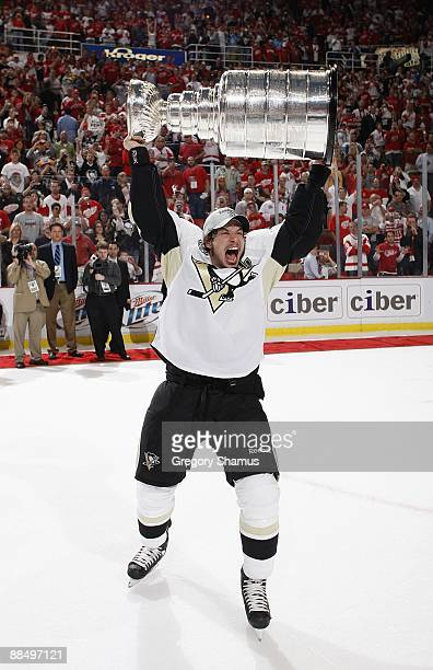 Sidney Crosby of the Pittsburgh Penguins celebrates with the Stanley Cup after defeating the Detroit Red Wings 21 in Game Seven to win the 2009...