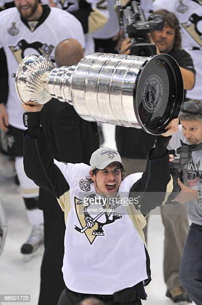 Sidney Crosby of the Pittsburgh Penguins celebrates with the Stanley Cup after the win against the Detroit Red Wings during Game Seven of the 2009...