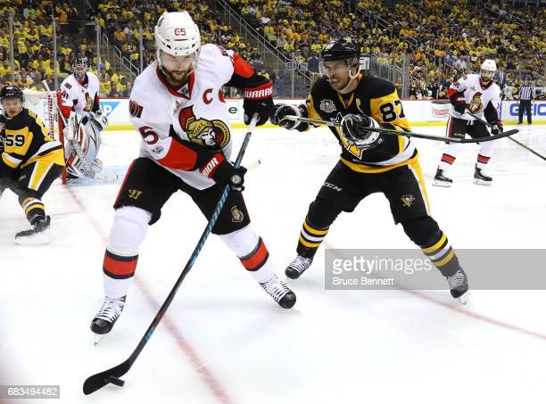 Sidney Crosby of the Pittsburgh Penguins checks Erik Karlsson of the Ottawa Senators during the second period in Game Two of the Eastern Conference...