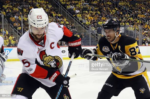 Sidney Crosby of the Pittsburgh Penguins checks Erik Karlsson of the Ottawa Senators in Game Two of the Eastern Conference Final during the 2017 NHL...