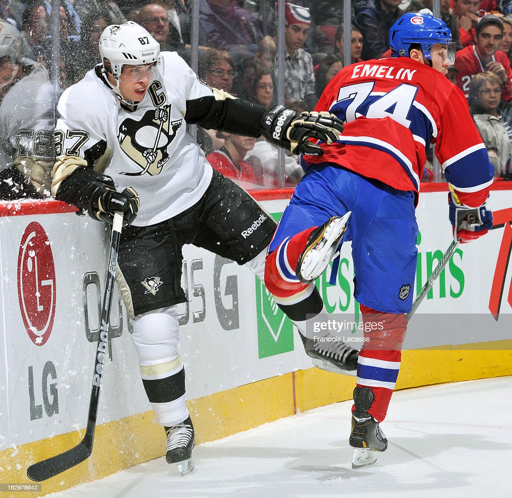 Sidney Crosby #87 of the Pittsburgh Penguins colides with defenceman Alexei Emelin #74 of the Montreal Canadiens during the NHL game on March 2, 2013 at the Bell Centre in Montreal, Quebec, Canada.