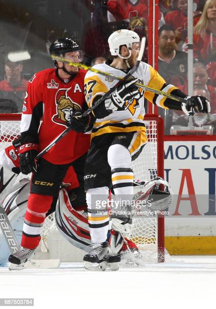 Sidney Crosby of the Pittsburgh Penguins collides with Dion Phaneuf of the Ottawa Senators during the second period in Game Six of the Eastern...