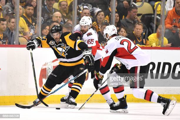 Sidney Crosby of the Pittsburgh Penguins collides with Erik Karlsson of the Ottawa Senators during the first period in Game Seven of the Eastern...