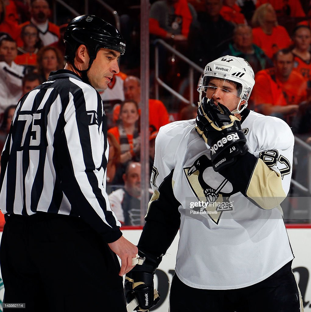 Sidney Crosby #87 of the Pittsburgh Penguins complains to linesman Derek Amell #75 in the first period against the Philadelphia Flyers in Game Six of the Eastern Conference Quarterfinals during the 2012 NHL Stanley Cup Playoffs at Wells Fargo Center on April 22, 2012 in Philadelphia, Pennsylvania. The Flyers won the game 5-1 to eliminate the Penguins from the playoffs.