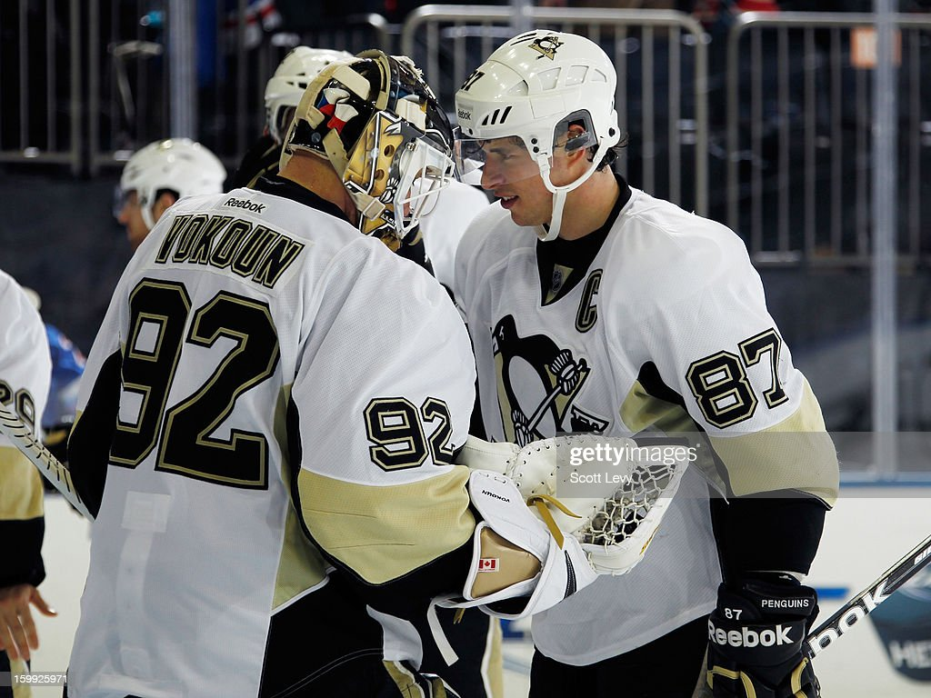 Sidney Crosby #87 of the Pittsburgh Penguins congratulates goaltender Tomas Vokoun #92 for the win against the New York Rangers at Madison Square Garden on January 20, 2013 in New York City. The Penguins defeat the Rangers 6-3.