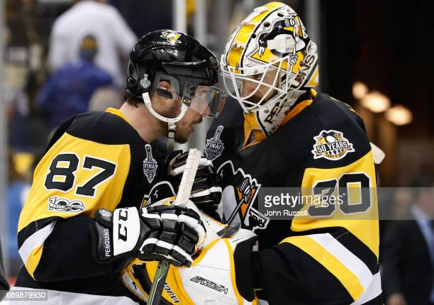 Sidney Crosby of the Pittsburgh Penguins congratulates goaltender Matt Murray after their 53 win over the Nashville Predators in Game One of the 2017...