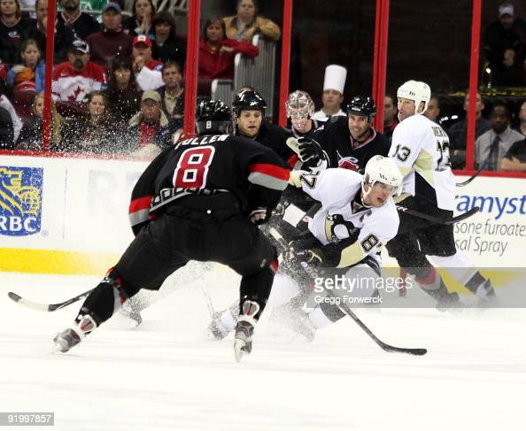 Sidney Crosby of the Pittsburgh Penguins controls the puck in their offensive zone during a NHL game against the Carolina Hurricanes on October 14...