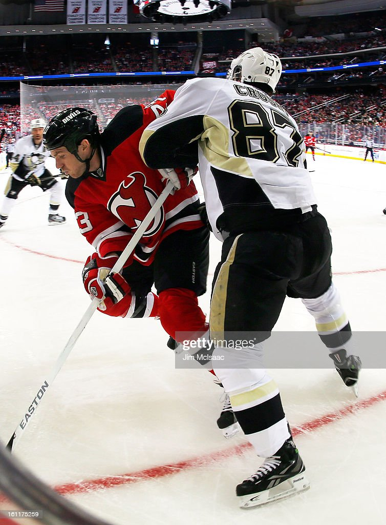 Sidney Crosby #87 of the Pittsburgh Penguins defends against David Clarkson #23 of the New Jersey Devils at the Prudential Center on February 9, 2013 in Newark, New Jersey.