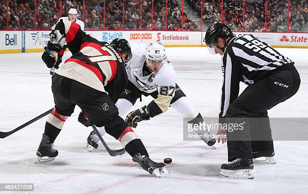 Sidney Crosby of the Pittsburgh Penguins faces off against Kyle Turris of the Ottawa Senators at Canadian Tire Centre on February 12 2015 in Ottawa...