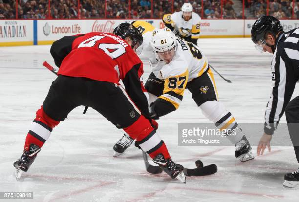 Sidney Crosby of the Pittsburgh Penguins faces off against JeanGabriel Pageau of the Ottawa Senators at Canadian Tire Centre on November 16 2017 in...