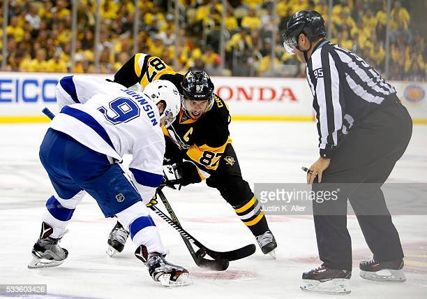 Sidney Crosby of the Pittsburgh Penguins faces off against Tyler Johnson of the Tampa Bay Lightning during the second period in Game Five of the...