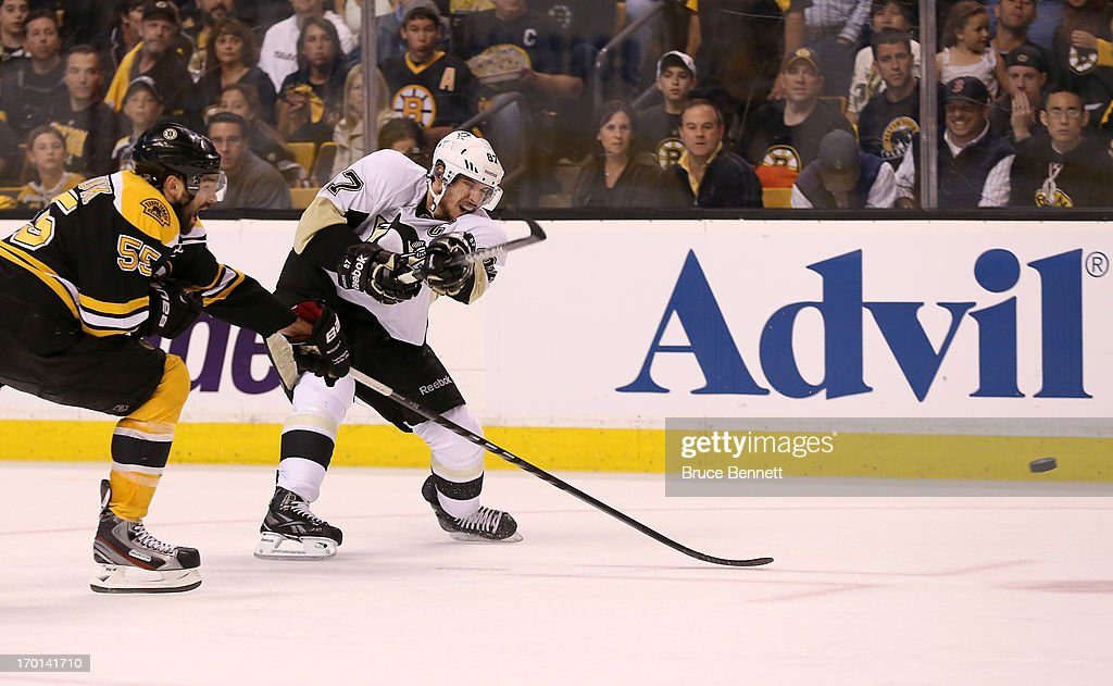 Sidney Crosby #87 of the Pittsburgh Penguins fires the puck against Johnny Boychuk #55 of the Boston Bruins in the second period in Game Four of the Eastern Conference Final during the 2013 NHL Stanley Cup Playoffs at the TD Garden on June 7, 2013 in Boston, United States.