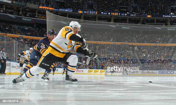 Sidney Crosby of the Pittsburgh Penguins follows through on a backhand pass against the Buffalo Sabres during an NHL game at the KeyBank Center on...