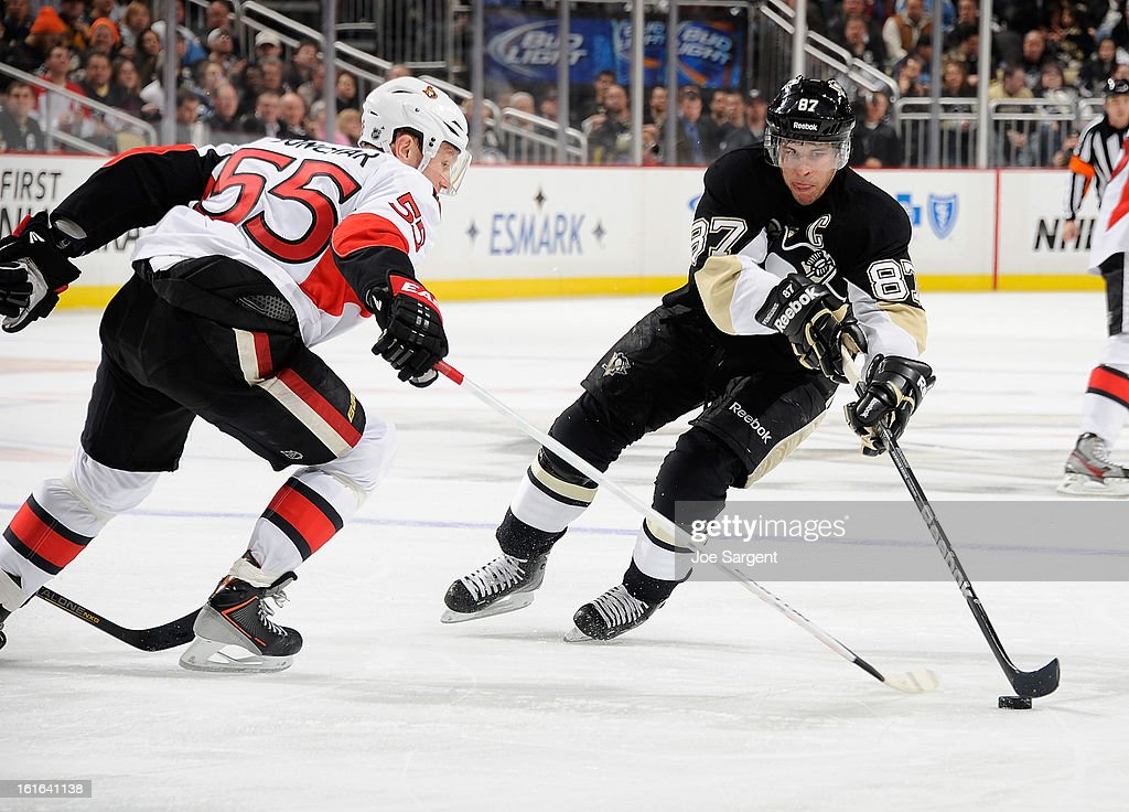 <a gi-track='captionPersonalityLinkClicked' href=/galleries/search?phrase=Sidney+Crosby&family=editorial&specificpeople=212781 ng-click='$event.stopPropagation()'>Sidney Crosby</a> #87 of the Pittsburgh Penguins gets past the defense of <a gi-track='captionPersonalityLinkClicked' href=/galleries/search?phrase=Sergei+Gonchar&family=editorial&specificpeople=202470 ng-click='$event.stopPropagation()'>Sergei Gonchar</a> #55 of the Ottawa Senators on February 13, 2013 at Consol Energy Center in Pittsburgh, Pennsylvania. Pittsburgh won the game 4-2.