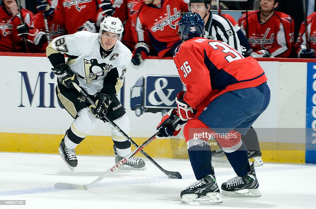 <a gi-track='captionPersonalityLinkClicked' href=/galleries/search?phrase=Sidney+Crosby&family=editorial&specificpeople=212781 ng-click='$event.stopPropagation()'>Sidney Crosby</a> #87 of the Pittsburgh Penguins handles the puck against Tomas Kundratek #36 of the Washington Capitals at the Verizon Center on February 3, 2013 in Washington, DC.