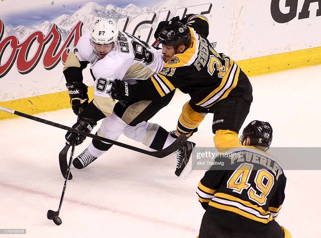 Sidney Crosby #87 of the Pittsburgh Penguins handles the puck against Andrew Ference #21 of the Boston Bruins in the third period in Game Four of the Eastern Conference Final during the 2013 Stanley Cup Playoffs at TD Garden on June 7, 2013 in Boston, Massachusetts.