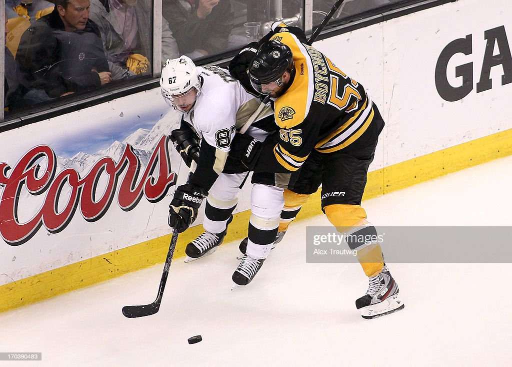 Sidney Crosby #87 of the Pittsburgh Penguins handles the puck against Johnny Boychuk #55 of the Boston Bruins in Game Four of the Eastern Conference Final during the 2013 Stanley Cup Playoffs at TD Garden on June 7, 2013 in Boston, Massachusetts.