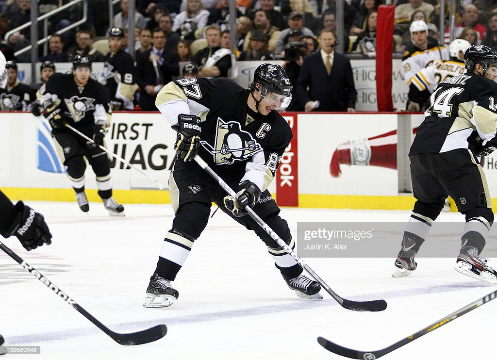 <a gi-track='captionPersonalityLinkClicked' href=/galleries/search?phrase=Sidney+Crosby&family=editorial&specificpeople=212781 ng-click='$event.stopPropagation()'>Sidney Crosby</a> #87 of the Pittsburgh Penguins handles the puck against the Boston Bruins during the game at Consol Energy Center on March 12, 2013 in Pittsburgh, Pennsylvania. The Penguins won 3-2.
