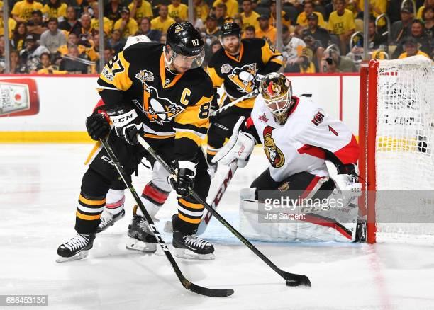 Sidney Crosby of the Pittsburgh Penguins handles the puck in front of Mike Condon of the Ottawa Senators in Game Five of the Eastern Conference Final...